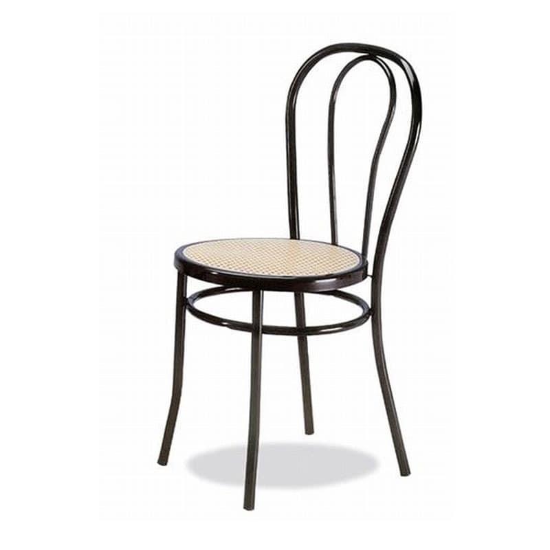 002, Stuhl aus gebogenem Metall, sitzt in Wien Stroh